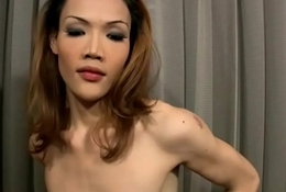 Skinny redhead ladyboy with low hanging balls tugs three cocks
