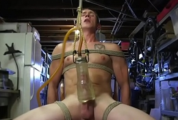 Sadomasochism sub secured up and toyed before jerking