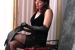 Brunette Milf teases in leather gloves