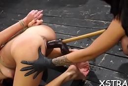 Slutty brunette drilled by heavy strapon