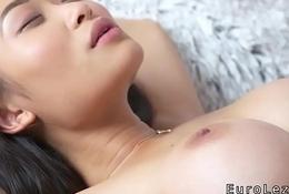 Petite Asian busty lesbian has oral sex