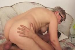 Spex granny rides hard cock before fellatio