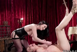 Suspended lesbian ass whipped in lezdom