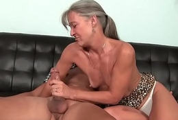 Mature slut tugs cock until a happy finish