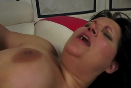 Chubby granny riding on a huge cock